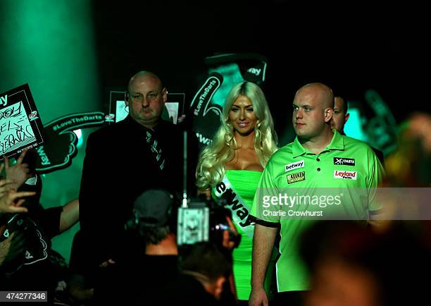 Michael van Gerwen of Holland makes his entrance during his semifinal match against Raymond van Barneveld during the Betway Premier League at The 02...