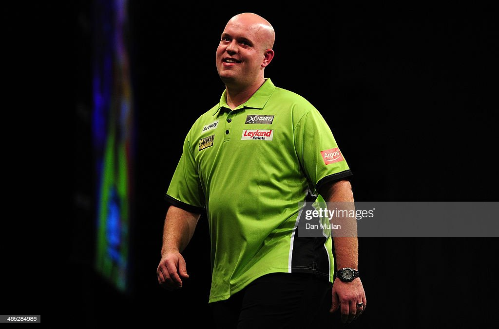 <a gi-track='captionPersonalityLinkClicked' href=/galleries/search?phrase=Michael+van+Gerwen&family=editorial&specificpeople=4754172 ng-click='$event.stopPropagation()'>Michael van Gerwen</a> of Holland reacts after missing a dart against Peter Wright of Scotland during The Betway Premier League Darts at Westpoint Arena on March 5, 2015 in Exeter, England.