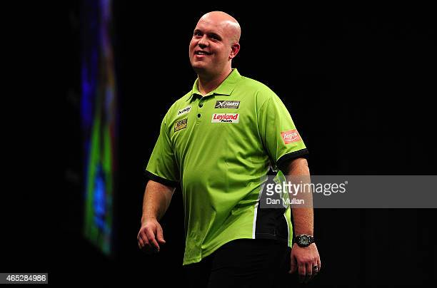 Michael van Gerwen of Holland reacts after missing a dart against Peter Wright of Scotland during The Betway Premier League Darts at Westpoint Arena...
