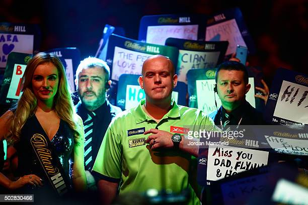 Michael van Gerwen of Holland walks in ahead of his third round match against Raymond van Barneveld of Holland on Day Eleven of the 2016 William Hill...