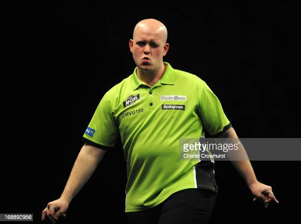 Michael Van Gerwen of Holland winces after going close during his semi final match against James Wades of England during the McCoy's Premier League...