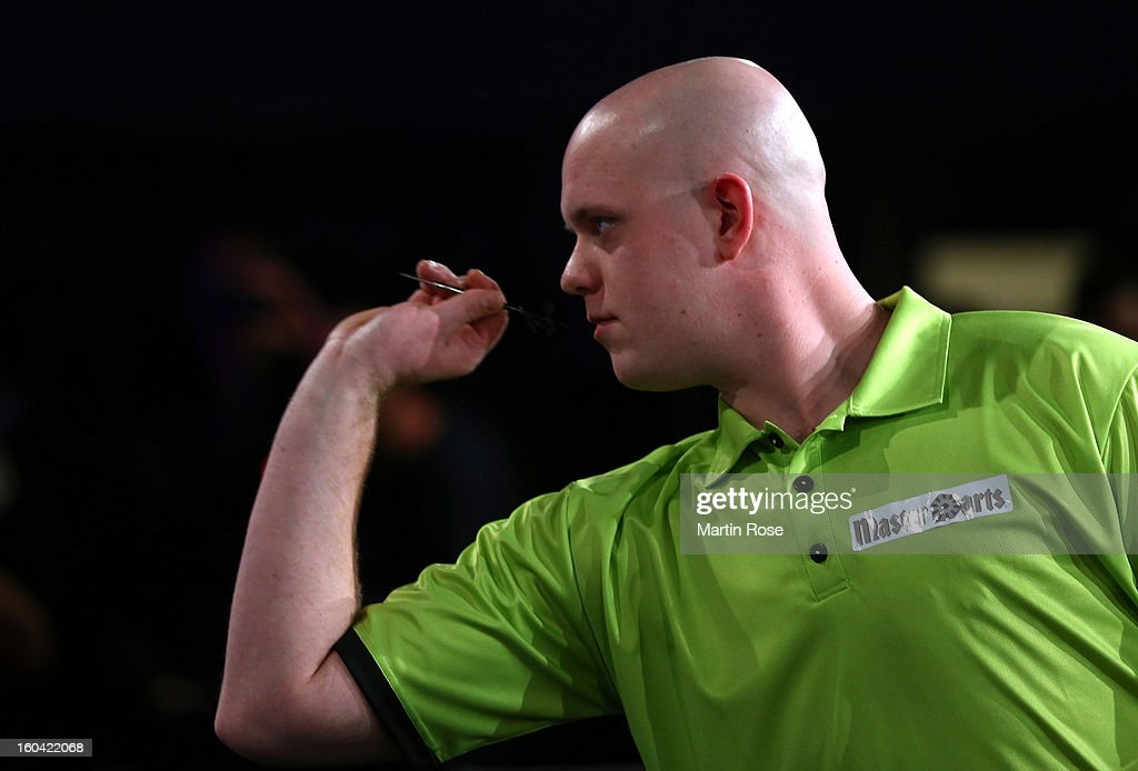 <a gi-track='captionPersonalityLinkClicked' href=/galleries/search?phrase=Michael+van+Gerwen&family=editorial&specificpeople=4754172 ng-click='$event.stopPropagation()'>Michael van Gerwen</a> of Netherlands in action during a dart show tournament at between team Netherlands and Hamburger SV at Imtech Arena on January 31, 2013 in Hamburg, Germany.