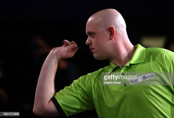 Michael van Gerwen of Netherlands in action during a dart show tournament at between team Netherlands and Hamburger SV at Imtech Arena on January 31...