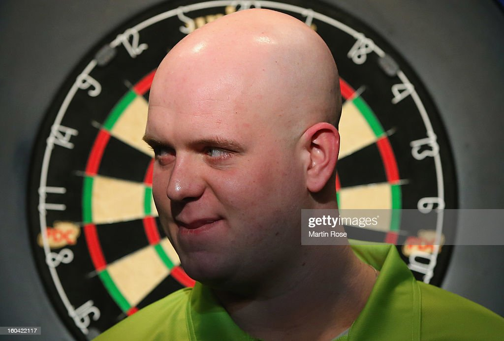 <a gi-track='captionPersonalityLinkClicked' href=/galleries/search?phrase=Michael+van+Gerwen&family=editorial&specificpeople=4754172 ng-click='$event.stopPropagation()'>Michael van Gerwen</a> of Netherlands looks on during a dart show tournament at between team Netherlands and Hamburger SV at Imtech Arena on January 31, 2013 in Hamburg, Germany.