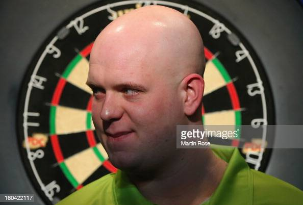 Michael van Gerwen of Netherlands looks on during a dart show tournament at between team Netherlands and Hamburger SV at Imtech Arena on January 31...