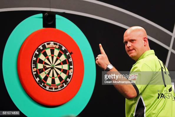Michael van Gerwen of the Netherlands celebrates a shot in his match against Phil 'The Power' Taylor of England during the Darts Betway Premier...