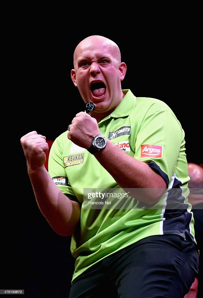 Michael Van Gerwen of the Netherlands celebrates after winning the 2015 Dubai Duty Free Darts Masters at Dubai Duty Free Tennis Stadium on May 29, 2015 in Dubai, United Arab Emirates.
