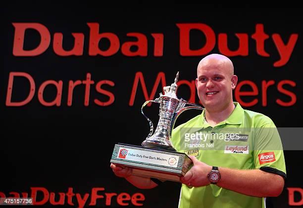 Michael Van Gerwen of the Netherlands celebrates after winning the 2015 Dubai Duty Free Darts Masters at Dubai Duty Free Tennis Stadium on May 29...