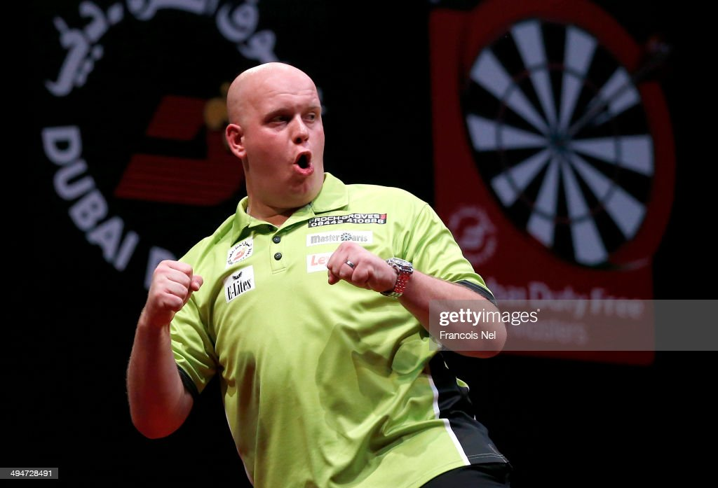 Michael Van Gerwen of the Netherlands celebrates after winning the 2014 Dubai Duty Free Darts Masters at Dubai Duty Free Tennis Stadium, Irish Village on May 30, 2014 in Dubai, United Arab Emirates.