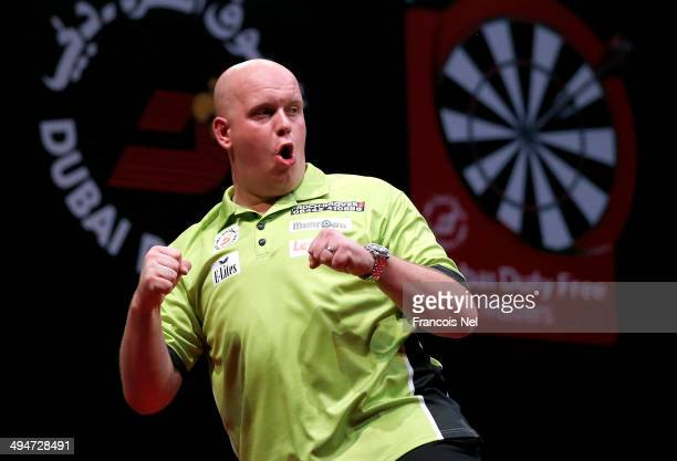 Michael Van Gerwen of the Netherlands celebrates after winning the 2014 Dubai Duty Free Darts Masters at Dubai Duty Free Tennis Stadium Irish Village...