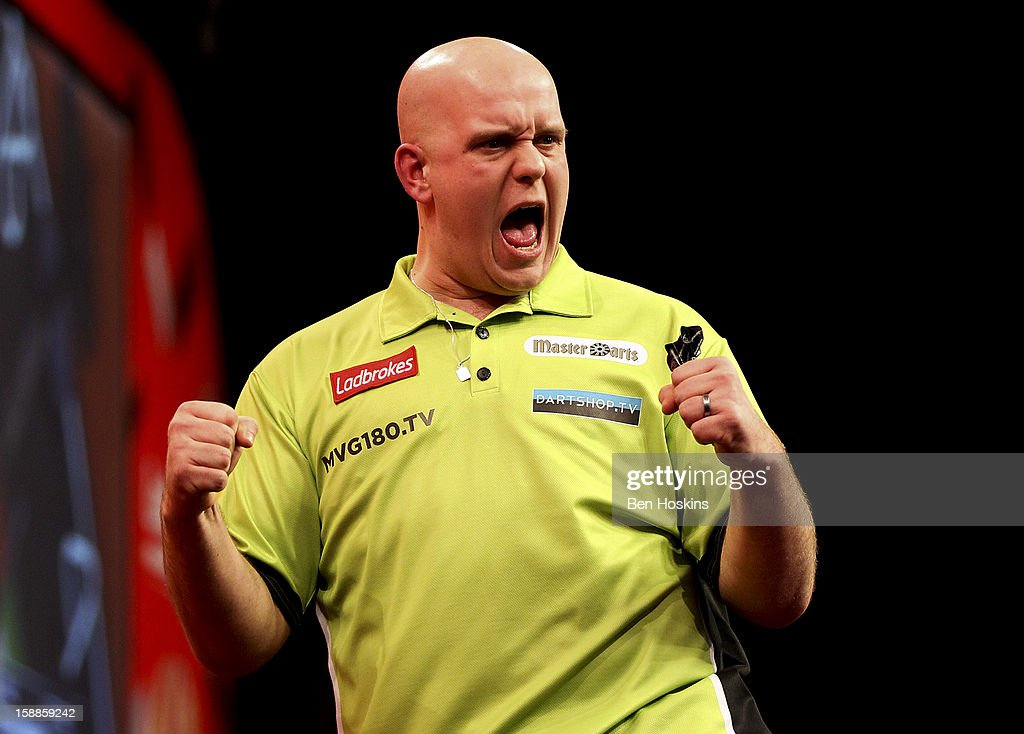 Michael van Gerwen of the Netherlands celebrates during the final of the 2013 Ladbrokes.com World Darts Championship at the Alexandra Palace on January 1, 2013 in London, England.