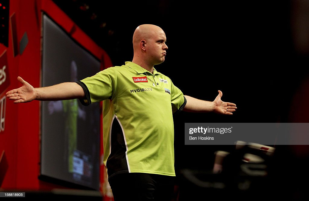 Michael van Gerwen of the Netherlands celebrates throwing a nine dart leg during his semi final match against James Wade of England on day fourteen of the 2013 Ladbrokes.com World Darts Championship at the Alexandra Palace on December 30, 2012 in London, England.