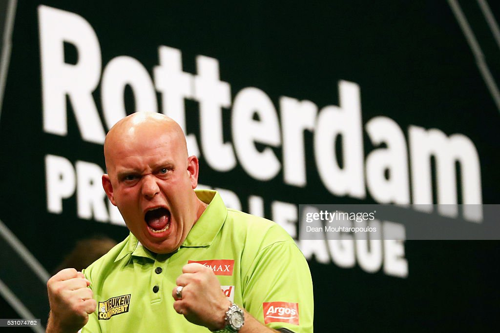 <a gi-track='captionPersonalityLinkClicked' href=/galleries/search?phrase=Michael+van+Gerwen&family=editorial&specificpeople=4754172 ng-click='$event.stopPropagation()'>Michael van Gerwen</a> of the Netherlands celebrates victory in his match against Phil 'The Power' Taylor of England during the Darts Betway Premier League Night 15 at Rotterdam Ahoy on May 12, 2016 in Rotterdam, .