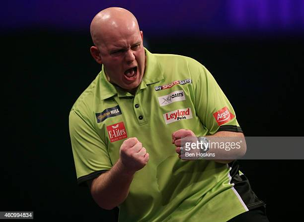 Michael van Gerwen of the Netherlands celebrates winning a leg during his semi final match against Gary Anderson of Scotland on day thirteen of the...