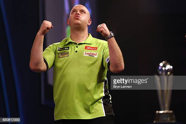 Michael van Gerwen of The Netherlands celebrates winning the final of the 2017 William Hill PDC World Darts Championships at Alexandra Palace on...