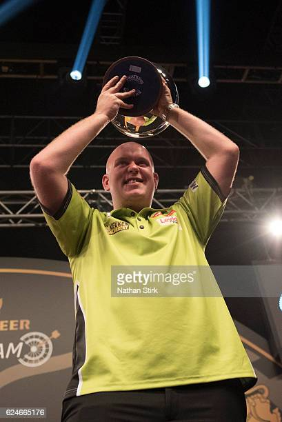 Michael van Gerwen of the Netherlands celebrates winning the SINGHA Beer Grand Slam of Darts against James Wade at Wolverhampton Civic Hall on...