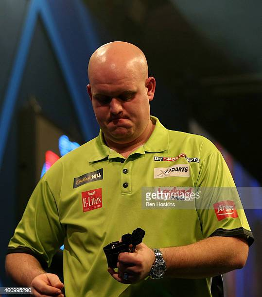 Michael van Gerwen of the Netherlands looks dejected after losing his semi final match against Gary Anderson of Scotland on day thirteen of the 2015...