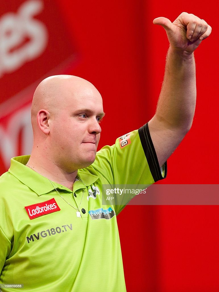 Michael van Gerwen of the Netherlands reacts after being defeated by Phil Taylor of Britain in the PDC World Championship darts final at Alexandra Palace in north London on January 1, 2013. Taylor ended up winning the match 7 sets to 4. AFP PHOTO/Leon Neal