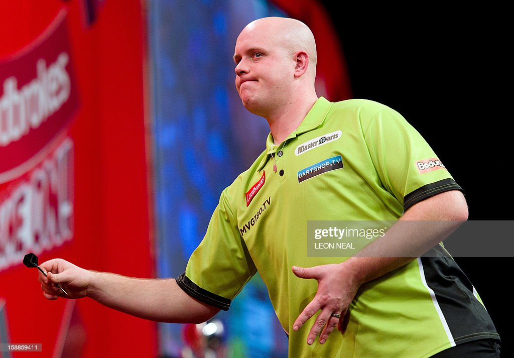 Michael van Gerwen of the Netherlands reacts as he takes part in the PDC World Championship darts final against Phil Taylor of Britain, at Alexandra Palace in north London on January 1, 2013. AFP PHOTO/Leon Neal