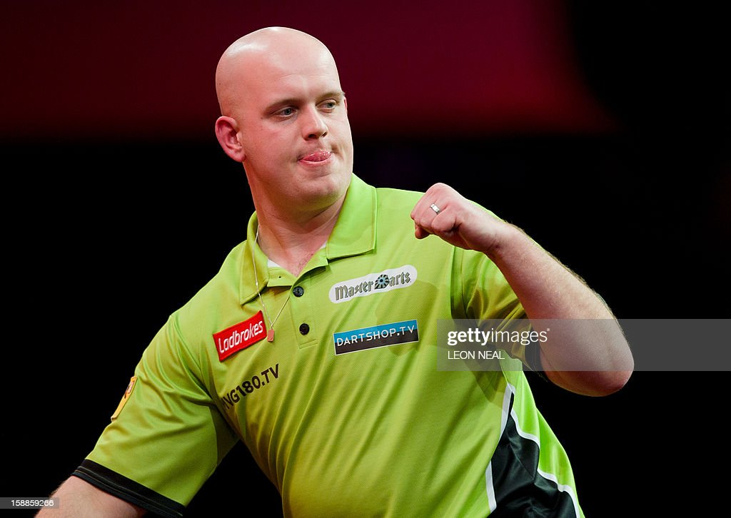 Michael van Gerwen of the Netherlands reacts during the PDC World Championship darts final against Phil Taylor of Britain, at Alexandra Palace in north London on January 1, 2013. AFP PHOTO/Leon Neal