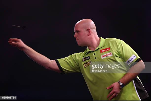 Michael van Gerwen of The Netherlands throws against Gary Anderson of Great Britain during the final of the 2017 William Hill PDC World Darts...
