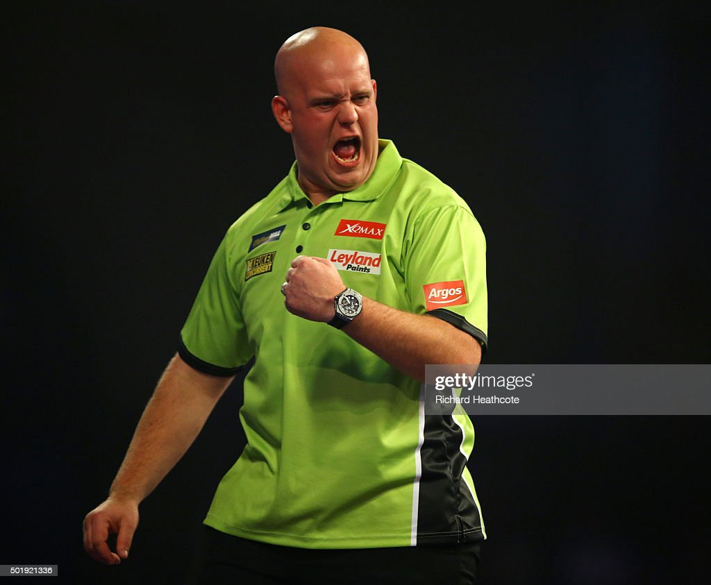 <a gi-track='captionPersonalityLinkClicked' href=/galleries/search?phrase=Michael+van+Gerwen&family=editorial&specificpeople=4754172 ng-click='$event.stopPropagation()'>Michael van Gerwen</a> reacts during his first round match against Rene Eidams on day two of the 2016 William Hill PDC World Darts Championships at Alexandra Palace on December 18, 2015 in London, England.