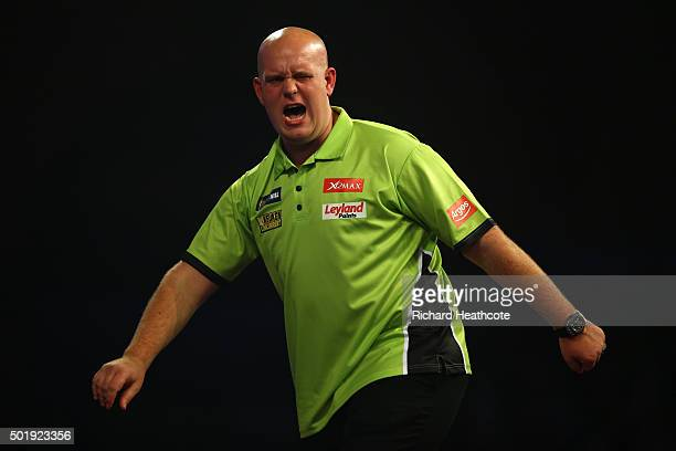 Michael van Gerwen reacts during his first round match against Rene Eidams on day two of the 2016 William Hill PDC World Darts Championships at...