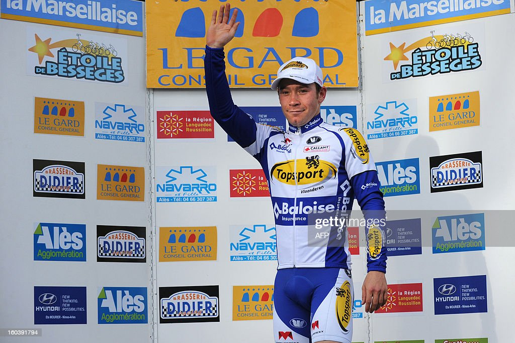 Michael Van Staeyen of Belgium celebrates on the podium after winning the first stage run between Bellegarde and Beaucaire during the 43rd edition of the Etoile de Besseges cycling race on January 30, 2013 in Beaucaire, southern France. AFP PHOTO / SYLVAIN THOMAS