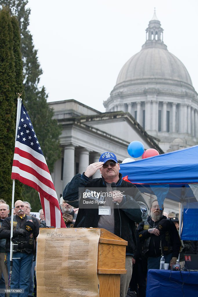 G. Michael VanAlstine leads the crowd in reciting the Pledge of Allegiance at the beginning of a pro-gun rally on January 19, 2013 in Olympia, Washington. The Guns Across America national campaign drew thousands of protesters to state capitols, including over 1,000 in Olympia.