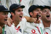Michael Vaughan captain of England celebrates with a replica Ashes Urn as he joins team mates in song after England regained the Ashes during day...
