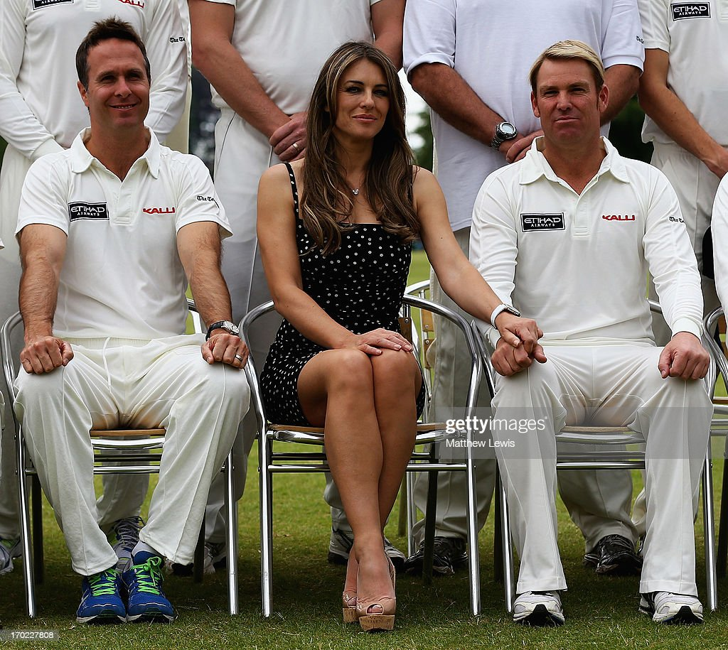 Michael Vaughan, Elizabeth Hurley and Shane Warne look on during the Shane Warne's Australia vs Michael Vaughan's England T20 match at Circenster Cricket Club on June 9, 2013 in Cirencester, England.