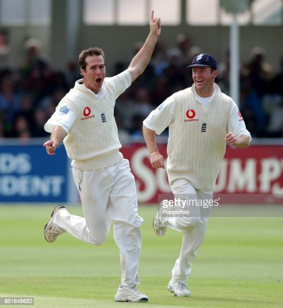 Michael Vaughan of England celebrates with his team mate Craig White after bowling Sachin Tendulkar of India for 92 during the Second npower Test...
