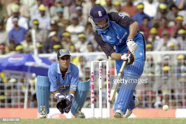 Michael Vaughn of England hits a four as Indian keeper Ajay Ratra look on during their third oneday match at the MA Chidambaram stadium in Madras 25...