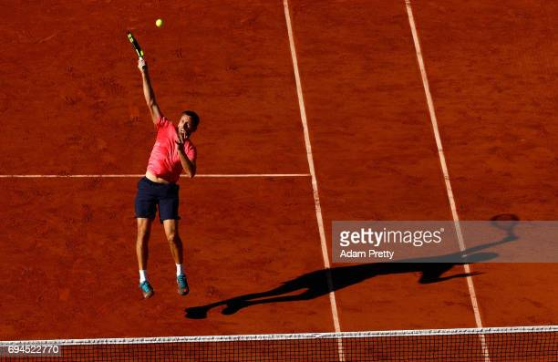 Michael Venus of New Zealand partner of Ryan Harrison of The United States returns the ball during the mens doubles final match against Donald Young...
