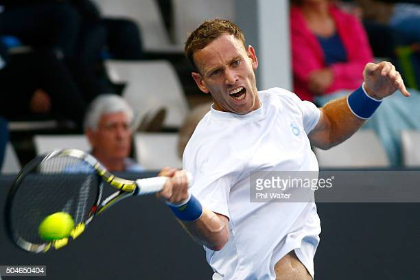 Michael Venus of New Zealand play a forehand against Benoit Paire of France on Day 8 of the ASB Classic on January 12 2016 in Auckland New Zealand