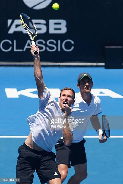 Michael Venus of New Zealand plays a forehand with Mate Pavic of Croatia against Eric Butorac and Scott Lipsky of the USA in their doubles final on...