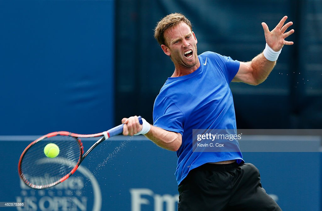 Michael Venus of New Zealand returns a forehand to Jack Sock during the BB&T Atlanta Open at Atlantic Station on July 23, 2014 in Atlanta, Georgia.