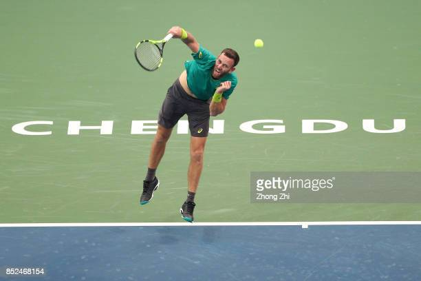 Michael Venus of New Zealand serves during the match against Zihao Xia of China during Qualifying first round of 2017 ATP Chengdu Open at Sichuan...