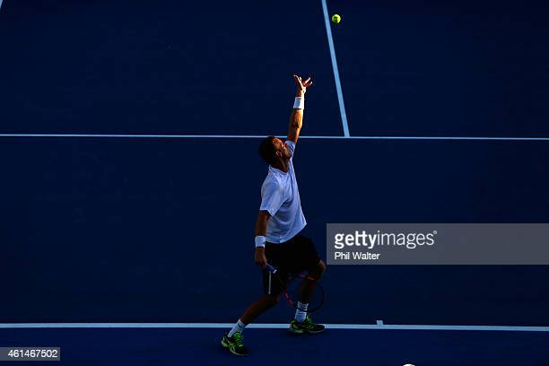 Michael Venus of New Zealand serves in his singles match against Alejandro Gonzalez of Colombia during day two of the 2015 Heineken Open Classic at...