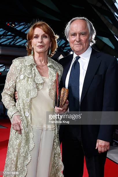 Michael Verhoeven and his wife Senta Berger attend the Munich Film Festival 2013 Cine Merit Award 2013 at BMW World on July 01 2013 in Munich Germany