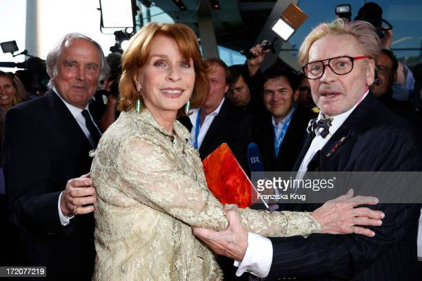 Michael Verhoeven Senta Berger and Helmut Berger attend the Munich Film Festival 2013 Cine Merit Award 2013 at BMW World on July 01 2013 in Munich...