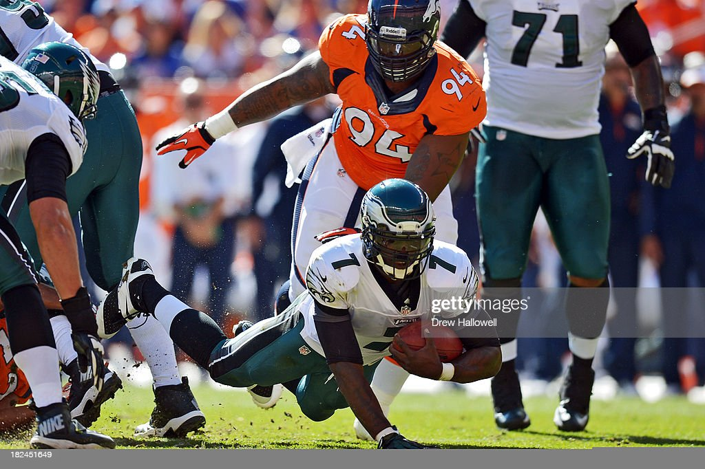 Michael Vick #7 of the Philadelphia Eagles dives for extra yards against the Denver Broncos at Sports Authority Field at Mile High on September 29, 2013 in Denver, Colorado.
