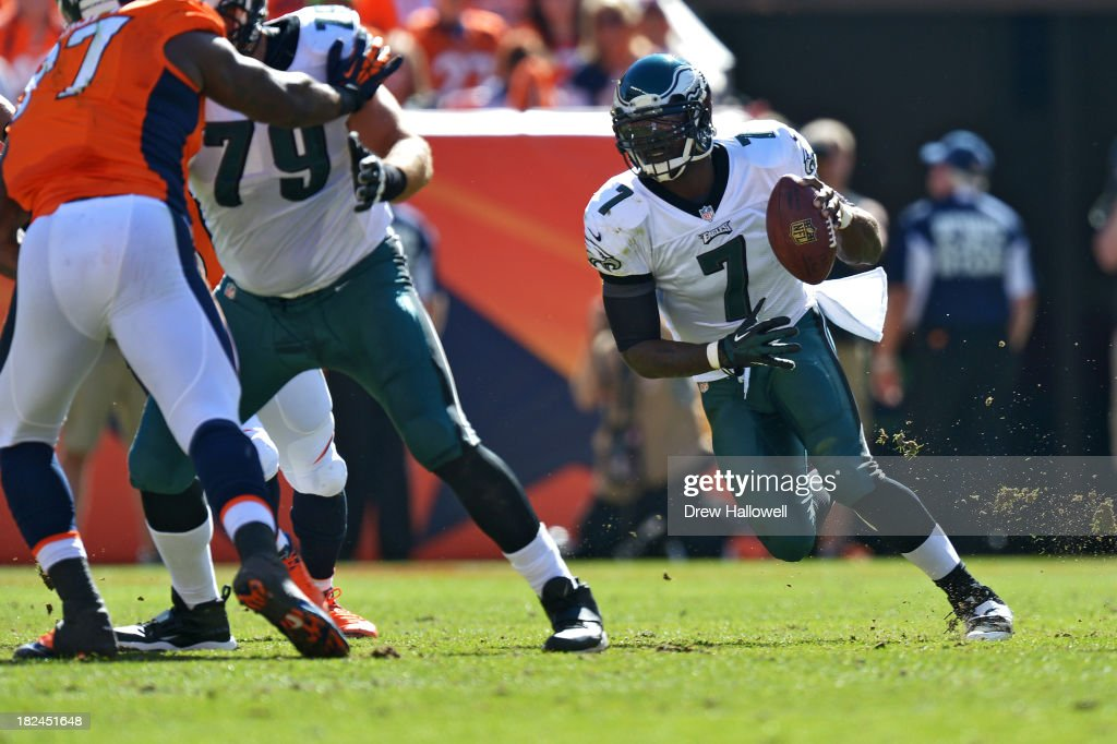 Michael Vick #7 of the Philadelphia Eagles scrambles against the Denver Broncos at Sports Authority Field at Mile High on September 29, 2013 in Denver, Colorado.