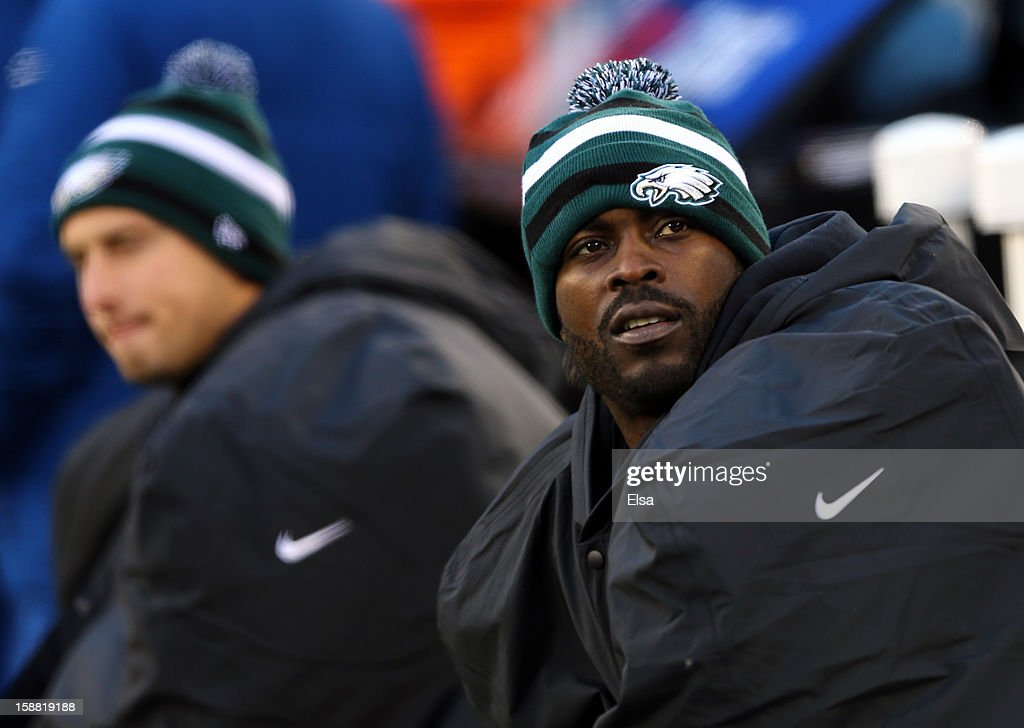 Michael Vick #7 of the Philadelphia Eagles sits on the bench in the fourth quarter against the New York Giants at MetLife Stadium on December 30, 2012 in East Rutherford, New Jersey. The New York Giants defeated the Philadelphia Eagles 42-7.