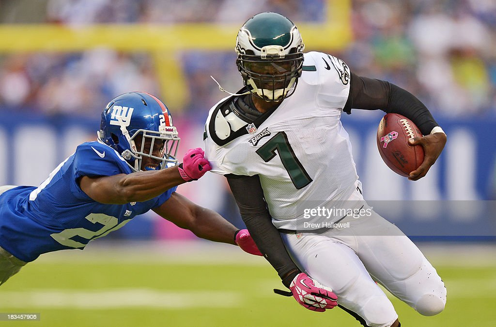 <a gi-track='captionPersonalityLinkClicked' href=/galleries/search?phrase=Michael+Vick&family=editorial&specificpeople=201746 ng-click='$event.stopPropagation()'>Michael Vick</a> #7 of the Philadelphia Eagles tries to outrun <a gi-track='captionPersonalityLinkClicked' href=/galleries/search?phrase=Prince+Amukamara&family=editorial&specificpeople=6357867 ng-click='$event.stopPropagation()'>Prince Amukamara</a> #20 of the New York Giants at MetLife Stadium on October 6, 2013 in East Rutherford, New Jersey. The Eagles won 36-21.