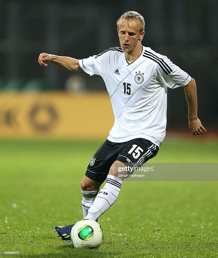 Michael Vitzthum of Germany runs with the ball during the 2015 UEFA European U21 Championships Qualifying Group Six match between Germany U21 and Faroe Islands U21 at Auestadion on October 15, 2013 in Kassel, Germany.