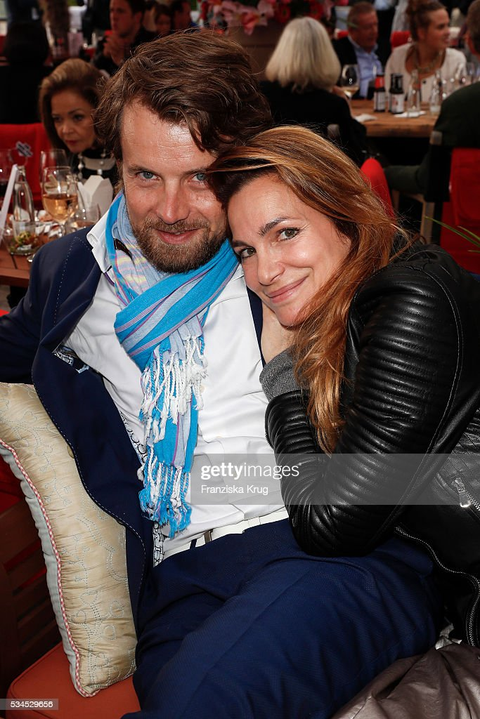 Michael von Hassel and german actress <a gi-track='captionPersonalityLinkClicked' href=/galleries/search?phrase=Alexandra+Kamp&family=editorial&specificpeople=875133 ng-click='$event.stopPropagation()'>Alexandra Kamp</a> during the 'Ein Herz fuer Kinder' summer party at Wannseeterrassen on May 26, 2016 in Berlin, Germany.