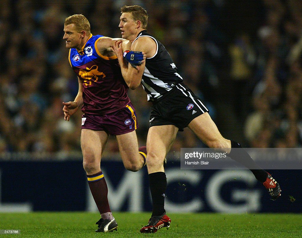 Michael Voss #3 for Brisbane contests with Nathan Buckley #5 for Collingwood during the AFL Second Qualifying Final between the Collingwood Magpies and the Brisbane Lions at the Melbourne Cricket Ground on September 6, 2003 in Melbourne, Australia.