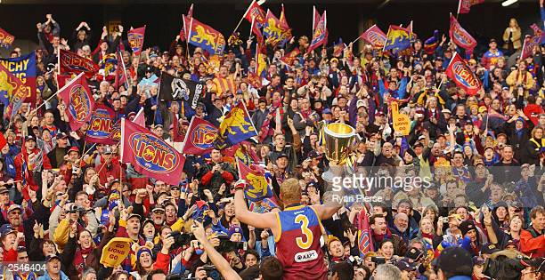 Michael Voss for the Lions celebrates with the crowd after the AFL Grand Final between the Collingwood Magpies and the Brisbane Lions at the...