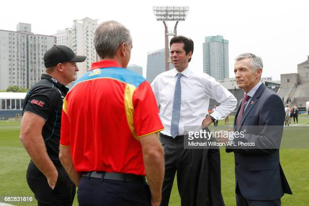 Michael Voss Midfield Manager of the Power Marcus Ashcroft GM Football Operations of the Suns Gillon McLachlan Chief Executive Officer of the AFL and...